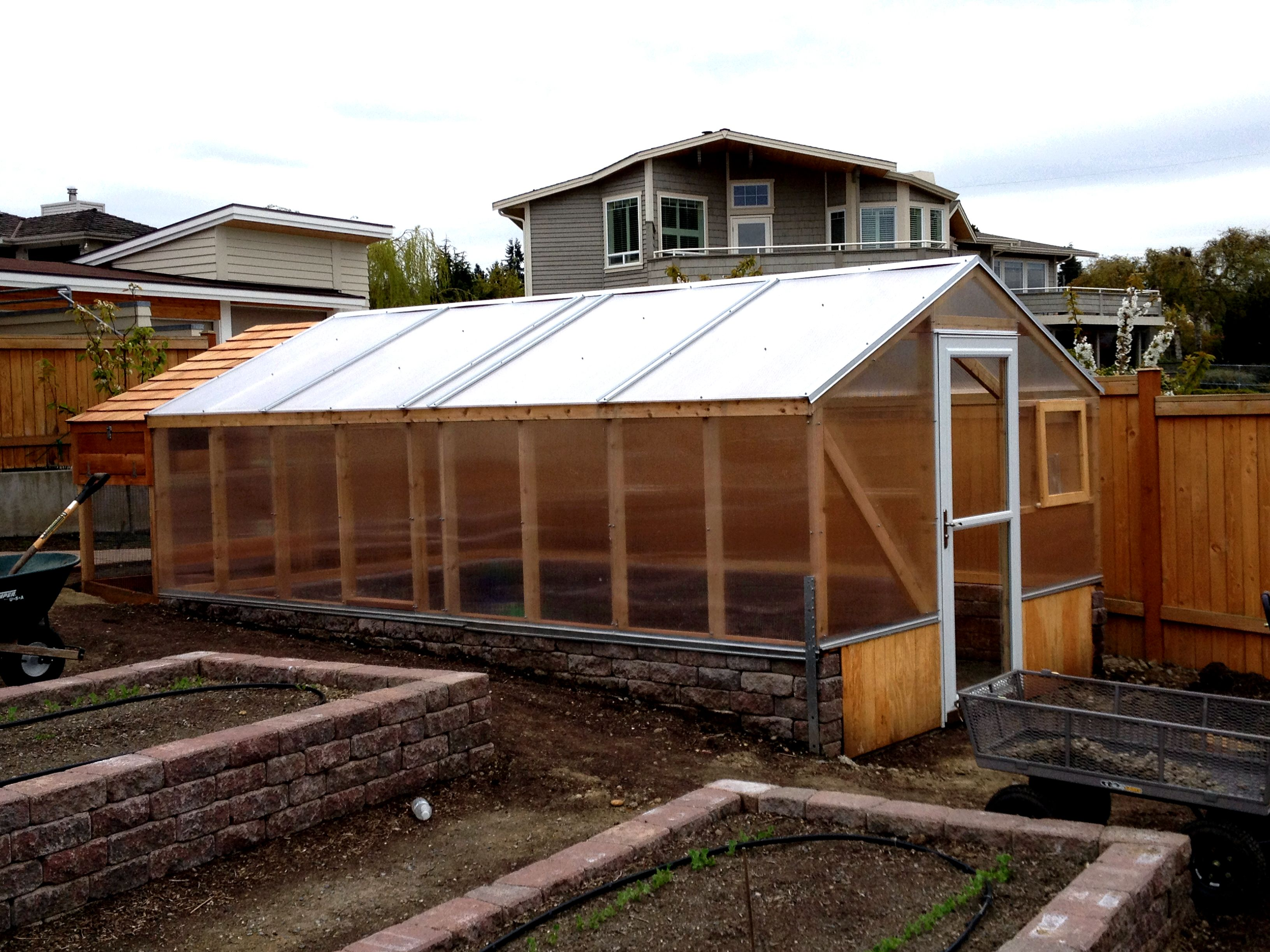 Chicken house and green house construction discourage burrowing predators from